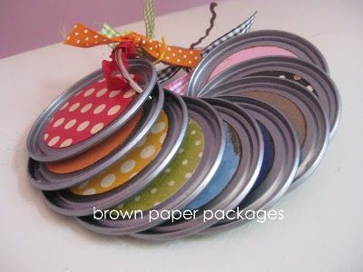 Using old metal lids (juice can lids or canning lids), make a quiet book.