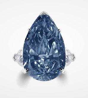 The Blue Ice - A rare fancy deep blue diamond ring set with pear shape diamond shoulders.
