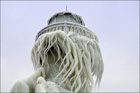 Frozen Lighthouses on Lake Michigan  The St. Joseph, Michigan outer range light is covered in a thick layer of twisted ice following a winter storm that created 20 foot waves on Lake Michigan. The splashes from those waves created interesting ice patterns on the tower. As the wind changed direction during the storm, the ice began to twist.