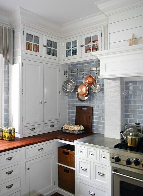 Love this!  White cabinets, blue subway tile, butcher block (darker stained). I think I'd like slightly more teal tile