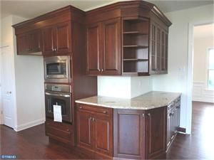 Great idea wrap around cabinets wrap around cabinets for Kitchen cabinet wraps
