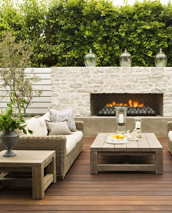 light colored brick on fireplace and natural wood tones