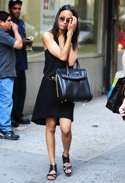 Loving that purse. Avatar beauty Zoe Saldana photographed getting lost in NYC on May 29th.