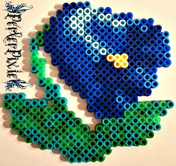 A pretty blue magic bell flower based off of the harvest moon video game series made out of perler beads. This one came off of the sprites from Harvest Moon Friends of Mineral Town.