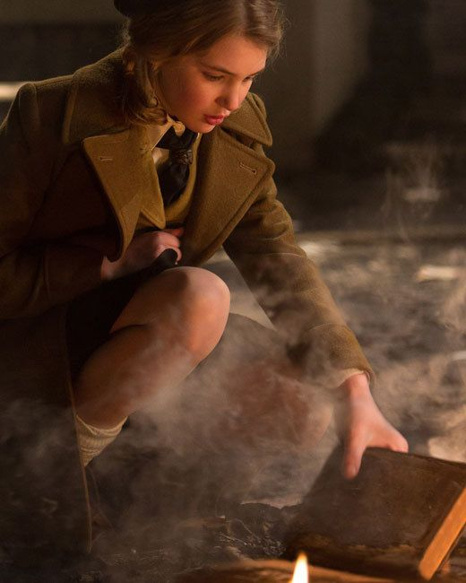 Liesel (Sophie Nélisse) rescues a book from a bonfire to pursue her love of reading.: