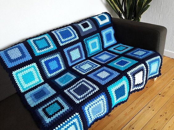 Do you know someone special who would just love this all blue, navy blue edged crochet blanket?