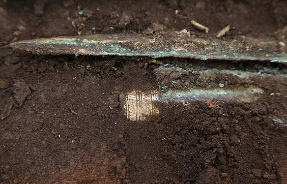 4,000-year-old gold-hilted Bronze Age sword found in Scotland.  rchaeologists have uncovered what could be a gold-hilted Bronze Age sword dating back as far as 4,000 years on the site of a new community football pitch in Carnoustie, Angus, in Scotland [Credit: Paul Reid]
