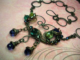 Steel retro-style heart necklace. Hand made with green n blues $ 45.00