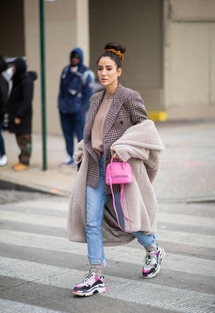 Tamara Kalinic is seen wearing plaid blazer pink Balenciaga bag denim jeans sneaker outside Zadig Voltaire during New York Fashion Week Autumn Winter...