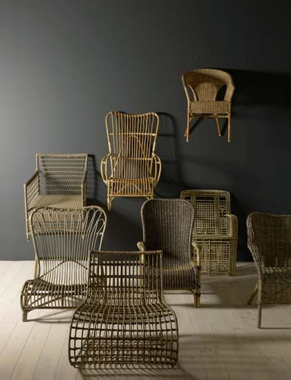 Lovely old wooden chairs displayed as works of art.