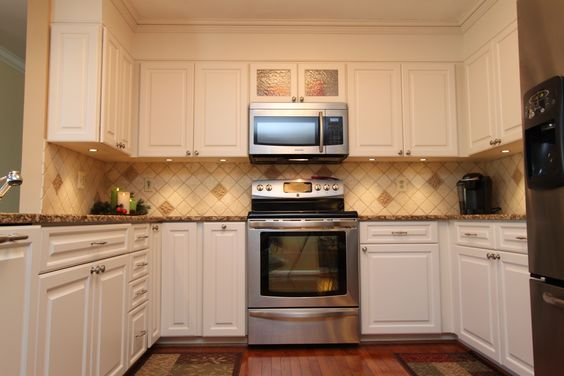 Transitional Kitchen With White Cabinets And Tan Granite