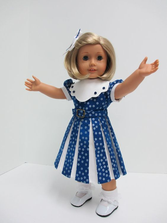 1930's Classic White and Royal Blue Cotton by karenstinytreasures. Kit is certainly joyful in this smart cotton dress made with modifications from a Keepers pattern. Karen used white kona cotton for the collar and for under the pleats of the skirt front. The large white collar has tiny blue buttons stitched on each scallop. A little belt closes with a mini buckle in front, while the dress closes in back with velcro.