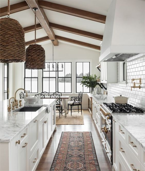 My Favorite Pins of the Week + Weekend Sale Alerts - Beautiful white kitchen with woven pendants and vintage runner   Marianne Simon Design