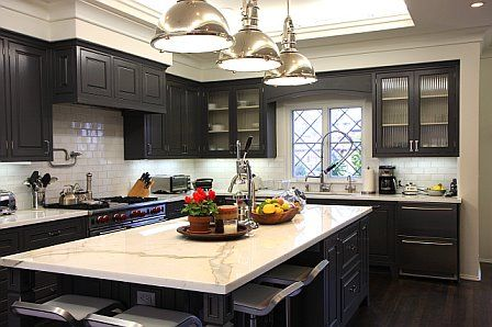 kitchen: dark cabinets and floor.  Like the counter tops