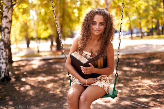 Curly haired brunette in short summer dress holding a book #hot #sexy #hairstyles #hairstyle #hair #long #short #buns #updo #braids #bang #blond #wedding #style #haircut #bridal #curly #bride #celebrity #black #white #trend #bob #girl #pantyhose #stockings #bikini #legs