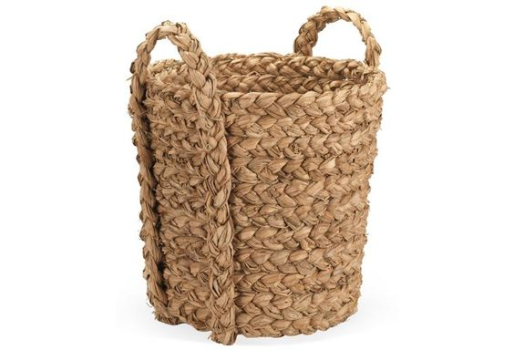 This rustic woven basket can be used for stashing all manner of clutter--from excess toys to shoes, to gardening tools, and much more.