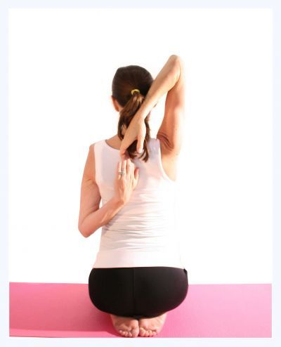 Prenatal yoga cow pose to help your shoulders.