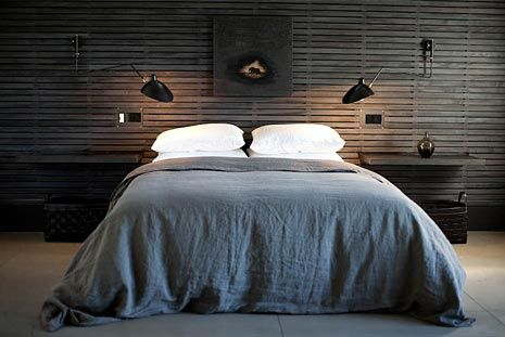:: BEDROOMS :: love the black wall sconces, dark wood panelling on the headboard wall ... only too bad the bedding wasn't fitted versus draped #bedrooms