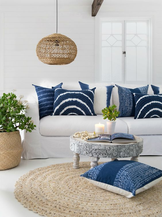 Coastal cottage living room decorated with indigo blue dye pillows