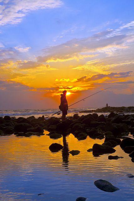 pescando en las piedras