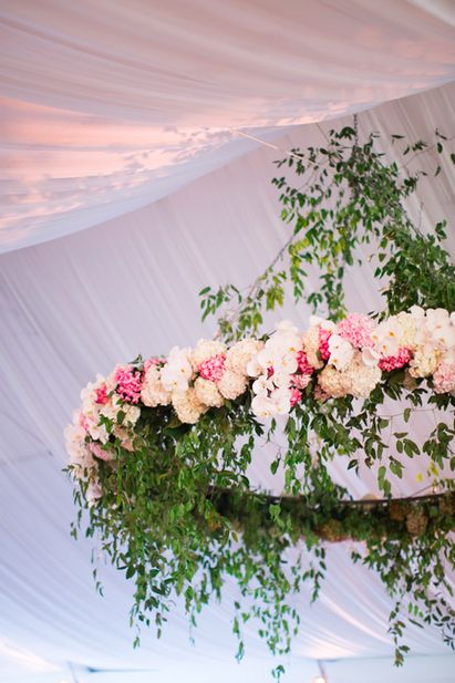 Pink, white and green floral chandelier wreath.