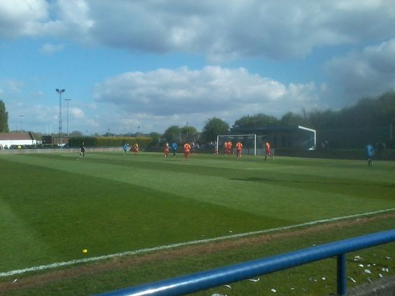 My local team, Wingate and Finchley FC, playing at home against Enfield Town FC, with Alexandra Palace in the distance.