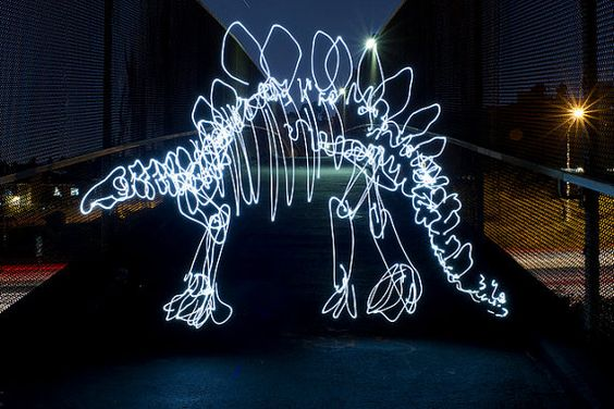 Stegosaurus by dariustwin: Darren Pearson is a graphic designer by day  who creates light paintings of dinosaurs at night by waving a flashlight beam in an 'intricate freehand style' in front of the open shutter of a digital camera for 5 - 10 minutes. So interesting because of its impermanence.  http://tinyurl.com/bmmqwbe