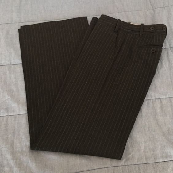 BCBG MaxAzaria Dress Pants - Size 0 In mint condition these pants are great for a day at the office. Inseam is a little over 30 inches, outseam is 39 inches, leg opening is a little over 10 inches. The color of these pants is dark charcoal with a light gray pinstripe. They are a light wool material. BCBGMaxAzria Pants Trousers