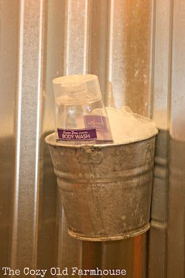 Inside the shower: little bucket for holding soap and things