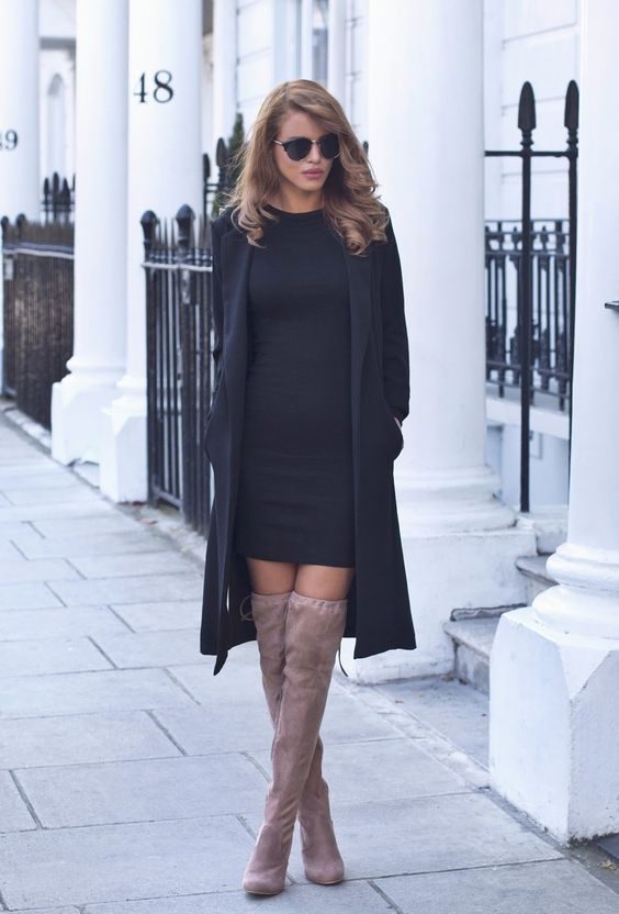 Nada Adelle wears mocha over the knee boots with cute black dress. Longline Blazer: Urban Outfitters, Mini Dress: Asos, Suede Boots: The Fashion Bible.