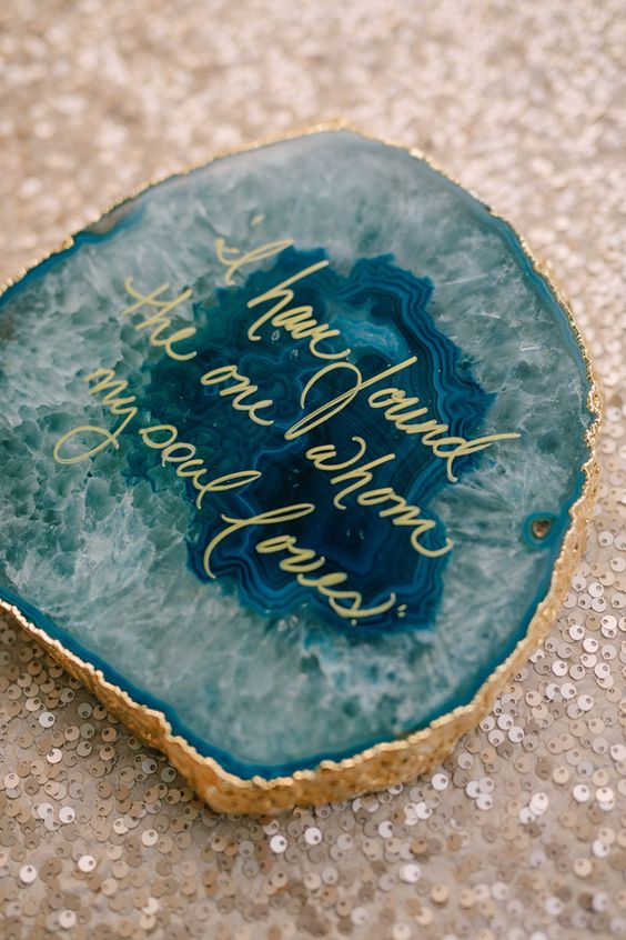Place agate rocks around your reception space with quotes that  revolve around love or your themed wedding!