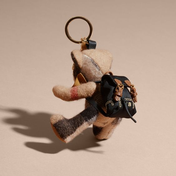 A Burberry charm featuring Thomas Bear, our signature teddy, in soft check cashmere.