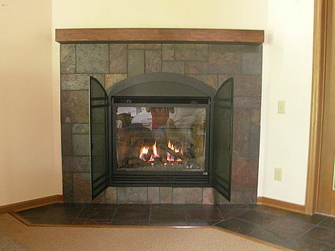 A Gas Fireplace With New Mantel And Custom Slate Designed And