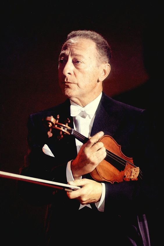 """Jascha Heifetz (1901-1987) was a Lithuanian-born American violinist. He was born in Vilnius. As a teen, he moved with his family to the United States, where his Carnegie Hall debut was rapturously received. He had a long and successful performing and recording career; after an injury to his right (bowing) arm, he focused on teaching. The New York Times called him """"perhaps the greatest violinist of all time."""""""