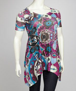 Sleek and sophisticated, this tunic takes top billing! The take-notice cutout design along the shoulders, bright pattern and smooth fabric with a hint of stretch give this top its appealing allure.