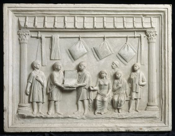 This relief sculpture shows a roman shop with customers