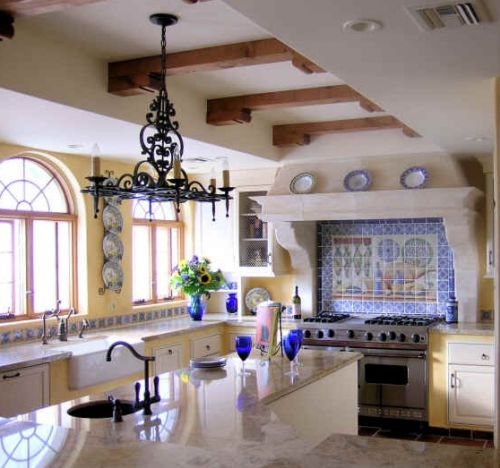 so much to like about this mexican style kitchen ..... What's not to like ?  The chandelier is spectacular ! Handmade tiles can be colour coordinated and customized re. shape, texture, pattern, etc. by ceramic design studios