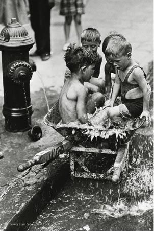 Kids from the Lower East Side NYC 1937. They were still doing this in the 50s! I can remember when they would open the fire hydrants on the hottest summer days and we would get to play in the water. What fun! They must have closed the streets off to do this, though I don't remember it.