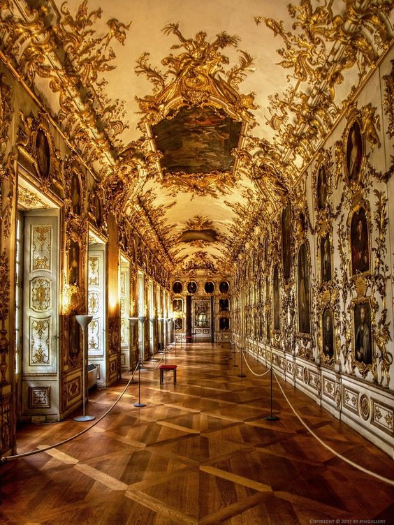 Versailles, Germany. dreamy golden french victorian hallway, palace, gold leaf ceiling mold, painted ceiling, ornate parket wood floor, white doors with gold molding. Was once somebody's home!