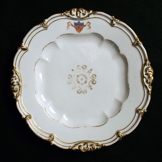 """James Knox Polk (1795-1849) was the 11th President of the United States (1845–1849).  The Polk service decoration was the first time red, white and blue colors were ever used on official white house state dinner china.  includes, on the border of most pieces, a polychrome shield of the United States behind the national motto on a floating ribbon/banner. (9.5"""" dinner plate)"""