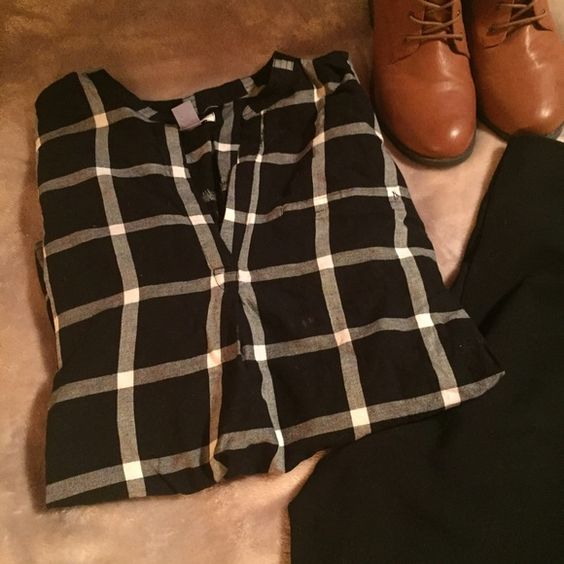 Flannel plaid pullover Black and white windowpane/plaid print. Worn once. Managed to get a couple bleach spots on it because my washer hates me. Bleach spots are small, one is mostly hidden by the pintuck on the v-neckline and the their two are also small and close together just a couple inches away from the first spot mentioned. Price reflects damage. Fits a little tight in the shoulders for me, so that's mostly why I'm selling, otherwise loose fit and much like the stock photo from the old…