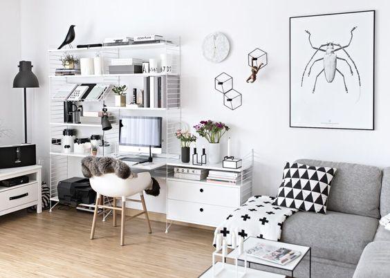 String shelving with desk in Scandinavian living room: