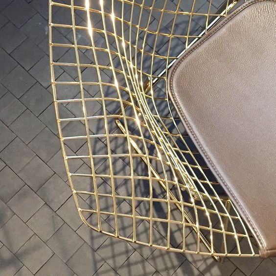 Knoll - This Bertoia Diamond Chair is gold-plated. #Bertoia #gold