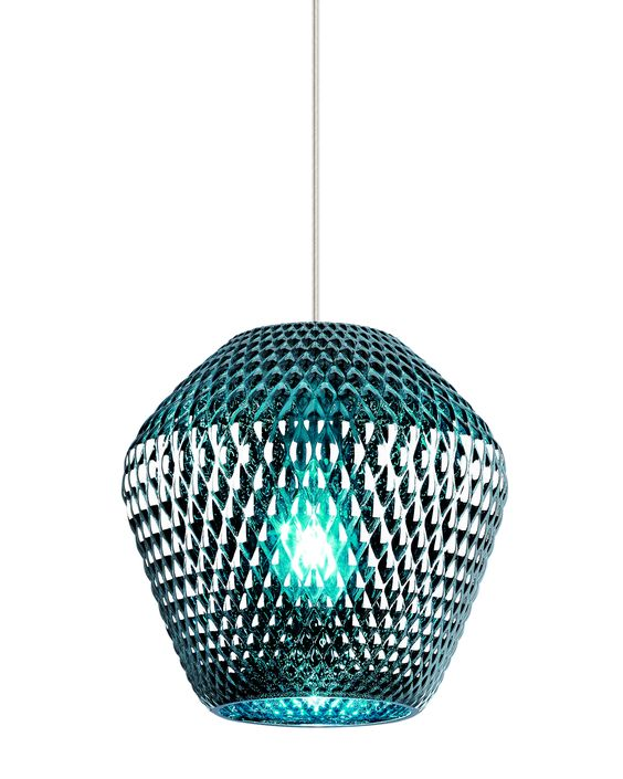 A special treatment process gives the molded glass shade of the Ornata pendant light from LBL Lighting features a rich metallic appearance. When turned off it is opaque, however when lit, it becomes translucent, allowing the colorful underlying glass to illuminate. Available in LED lighting. Shown here is the Aqua color glass.