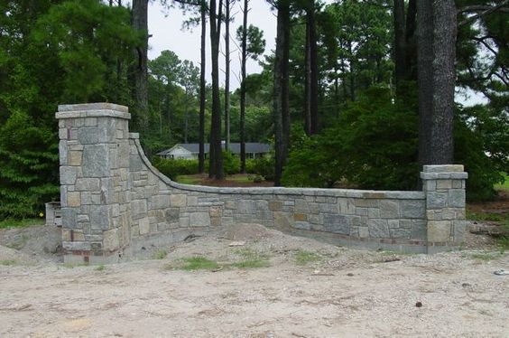 Landscape Designer: John Bowles of New Leaf Landscape Designs in Fayetteville, NC. Finished Retaining Wall at entrance of clients property.