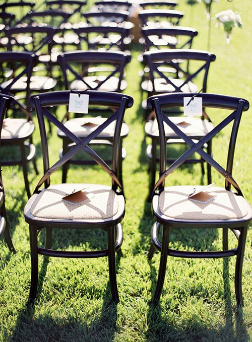 black cross-back chairs wedding ceremony