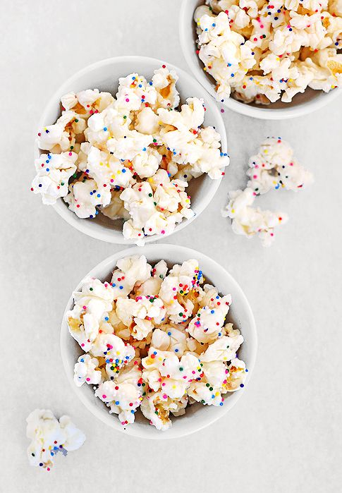 Super easy! Party Popcorn  from @Amy Johnson / She Wears Many Hats White chocolate + sprinkles!