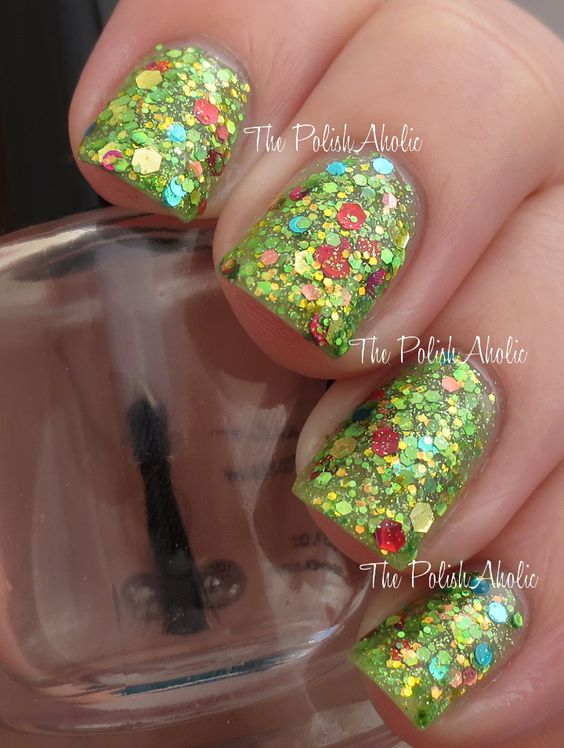 Femme FataleKeeper Of The Grove is a glitter bomb with green, red, gold and blue glitter in various sizes and shapes in a lime green jelly base. Th...  #blue #glitter #gold #hex #jelly #red #yellow #nails #nailpolish