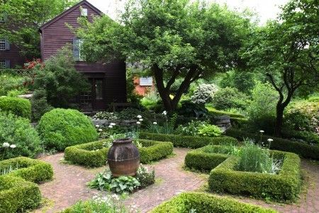 A quiet boxwood parterre - great evergreen structure to frame the formal food garden (via Martha Stewart Living)