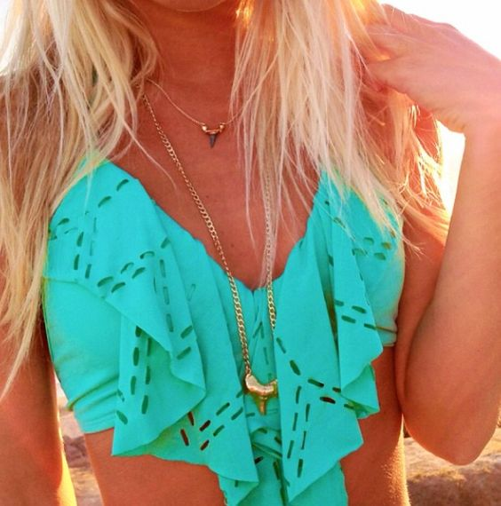 Turquoise flowing bathing suit-perfect. But seriously who wears a necklace with their bathing suit?